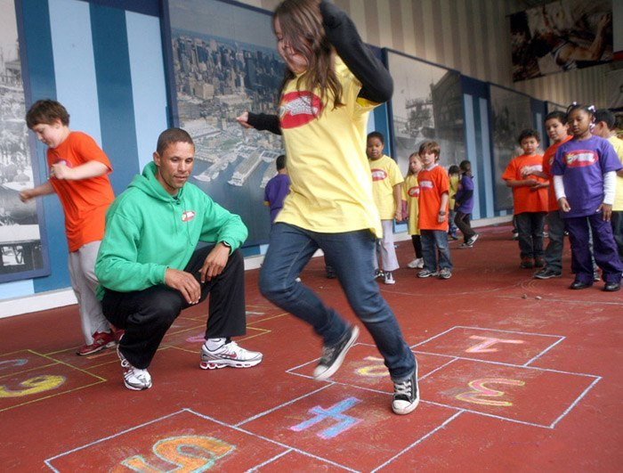 Kids Playing Hopscotch