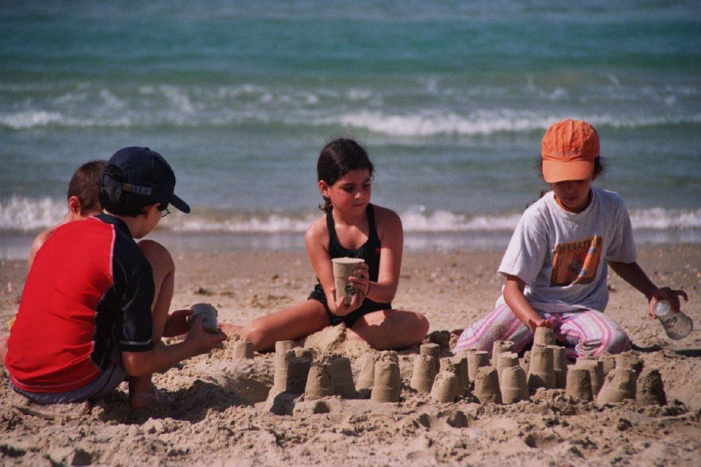 Kids building sandcastles