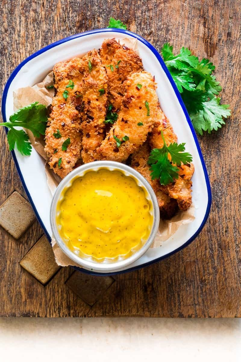 Baked Coconut Chicken Tenders Served with Mango Mustard Dipping Sauce