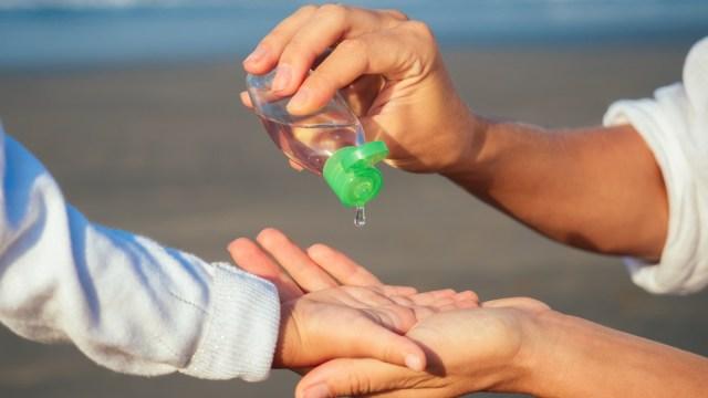 child-using-hand-sanitizer